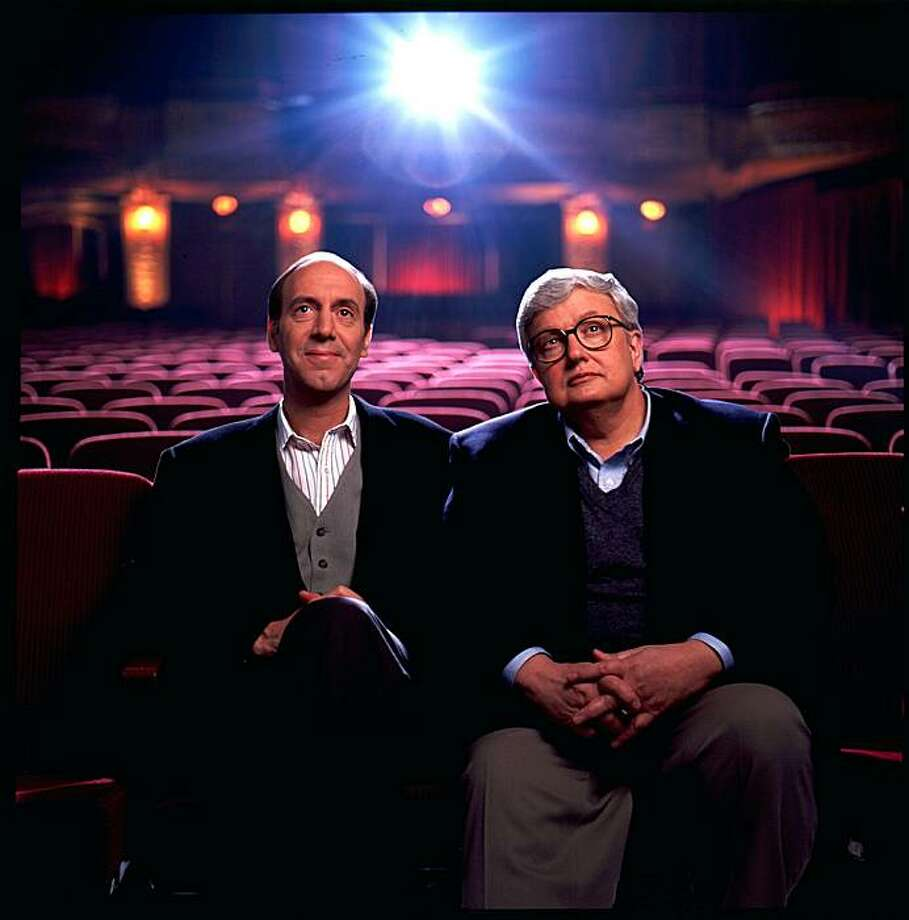 In this undated photo released by Disney-ABC Domestic Television, movie critics Roger Ebert, right, and Gene Siskel are shown. Starting Thursday, Aug. 2, 2007, a new web site touted as the largest collection of video-based movie reviews online will begin. The site will feature clips from the show that made the thumb famous and include 5,000 movie reviews, spanning more than 20 years of the show hosted by newspaper film critics Roger Ebert and the late Gene Siskel and columnist Richard Roeper. Photo: Disney Via AP