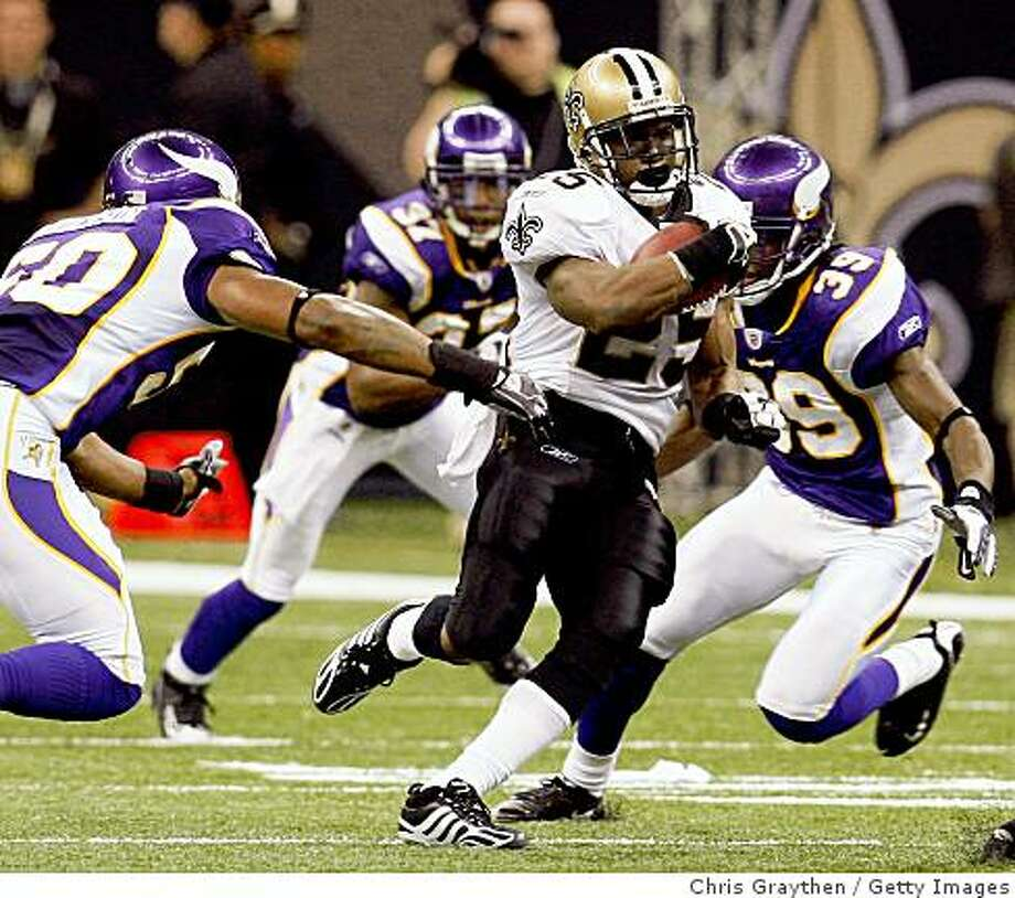 NEW ORLEANS - OCTOBER 06:  Reggie Bush #25 of the New Orleans Saints gets past Erin Henderson #50 of the Minnesota Vikings on October 6, 2008 at the Superdome in New Orleans, Louisiana.  Bush tied an NFL record by returning two punts for touchdowns in a game.  The Vikings defeated the Saints 30-27.  (Photo by Chris Graythen/Getty Images) Photo: Getty Images
