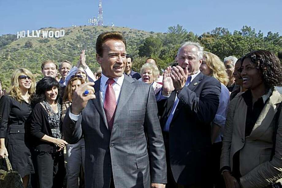 "California Gov. Arnold Schwarzenegger, left , joins Los Angeles City Councilman Tom LaBonge, right, and officials from the Trust for Public Land to announce the success of the ""Save the Cahuenga Peak"" campaign, after raising $12.5 million to acquire Cahuenga Peak, a 138-acre parcel of land just west of the landmark Hollywood sign on Monday, April 26, 2010, in Los Angeles. Photo: Damian Dovarganes, AP"
