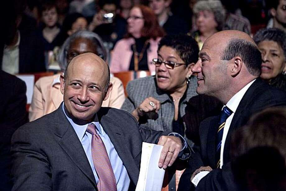 """Lloyd C. Blankfein, chairman and chief executive officer of Goldman Sachs Group Inc., left, sits with Gary D. Cohn, Goldman's president and chief operating officer, right, prior to a speech by U.S. President Barack Obama about financial reform at Cooper Union in New York, U.S., on Thursday, April 22, 2010. Obama called on the financial industry to drop its """"furious efforts"""" to fight his regulation plan, saying a failure to impose tougher rules on the market will put the U.S. economic system at risk. Photographer: Daniel Acker/Bloomberg *** Local Caption *** Gary D. Cohn; Lloyd C. Blankfein Photo: Daniel Acker, Bloomberg"""