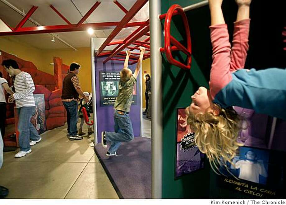"Harli Hobs, 5 o Hayward, Calif., right, is among the kids first to play on the new ""Run! Jump! Fly! Adventures in Action'' exhibit at the Bay Area Discovery Museum in Sausalito, Calif., on Saturday, Oct. 4, 2008. Photo: Kim Komenich, The Chronicle"