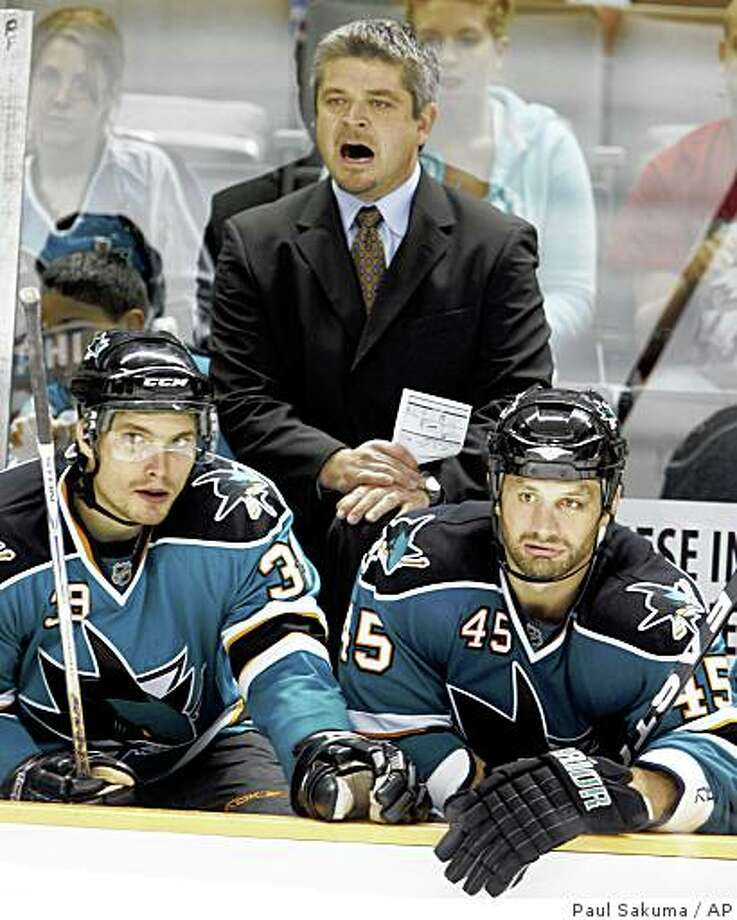 Sharks head coach Todd McLellan, upper center, shouts as center Tomas Plihal (39) and left wing Jody Shelley (45) sit on the bench in the third period of a preseason game against the Phoenix Coyotes in San Jose, Calif., Tuesday, Sept. 30, 2008. Photo: Paul Sakuma, AP