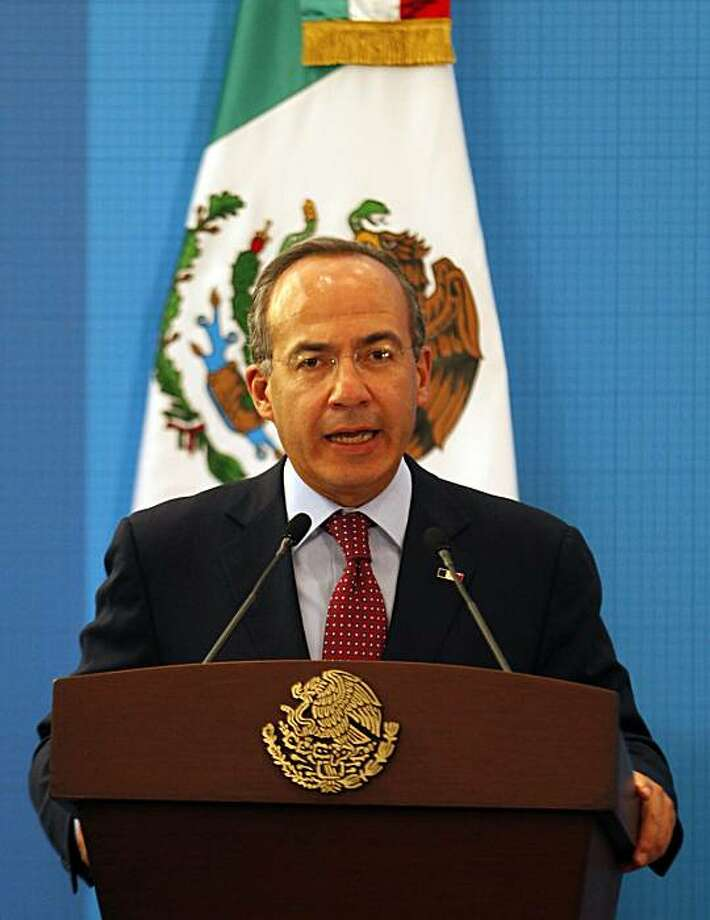 Mexico's President Felipe Calderon speaks during a news conference at the Los Pinos presidential residence in Mexico City, Monday, April 26, 2010. Earlier in the day, Calderon condemned Arizona's tough new immigration law as discriminatory and warned thatrelations with the U.S. border state will suffer. Photo: Eduardo Verdugo, AP