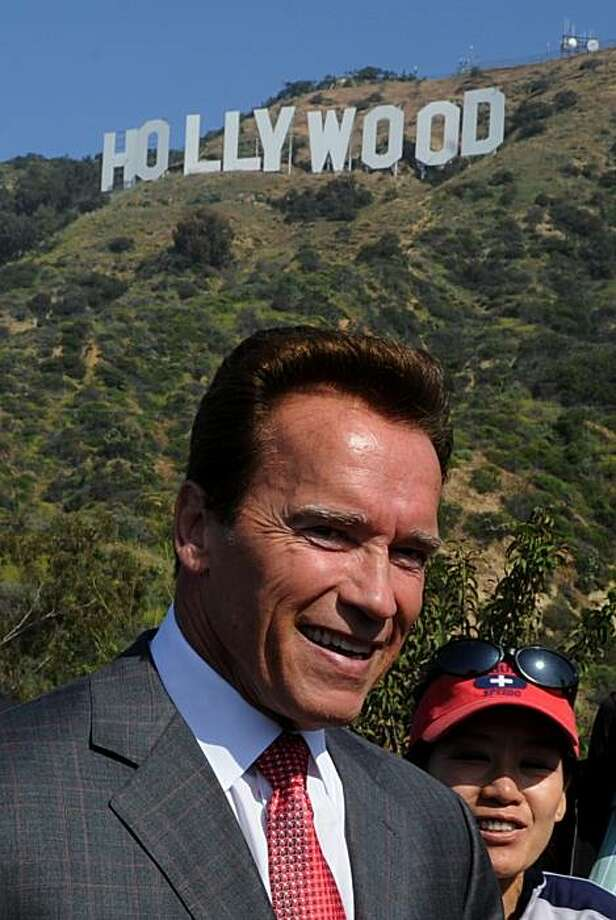 California Governor Arnold Schwarzenegger after making the announcement that sufficient money had been raised to purchase and protect the land around the historic Hollywood sign in Hollywood on April 26, 2010.  One of the City of Angels' most beloved attractions, views of the sign were in jeopardy and the group needed to find 12.5 million dollars to purchase the 138-acre (55-hectare) parcel of rugged land surrounding the sign from a Chicago-based consortium that had acquired rights to build four luxury mansions along the ridgeline. Playboy magazine founder Hugh Hefner made the final donation of $900,000 to reach the 12.5 million dollars required to complete the sale. Photo: Mark Ralston, AFP/Getty Images