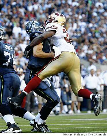 San Francisco 49ers Michael Lewis (32) sacks Seattle Seahawks Matt Hasselbeck (8) in the 4th quarter.The Seattle Seahawks host the San Francisco 49ers in a NFL game at Qwest Field in Seattle, Wash., on Sept. 14, 2008. The 49ers won 33-30 in overtime. Photo: Michael Maloney, The Chronicle
