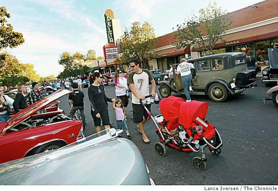 Families stroll up and down First Street in front of the town's only theater, the Delta Theater, during Oktoberfest, the Stride Show and Shine Car event held throughout the summer on Thursday's nights. Photo: Lance Iversen, The Chronicle