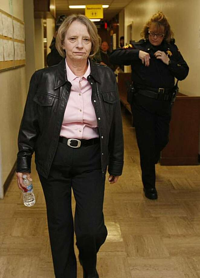 Former longtime San Francisco lab technician Deborah Madden is escorted from her arraignment for drug possession in a South San Francisco, Calif. courtroom, Monday, April 5, 2010. The San Francisco police crime lab was shut March 9, 2010 amid allegationsin December that Madden stole cocaine evidence. Madden was in court on Monday on an unrelated charge to the lab scandal. Photo: Paul Sakuma, AP