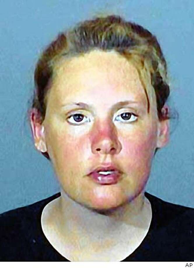 ** FILE ** This undated police booking photo released by the Los Angeles Sheriff's Department shows Emily Leatherman, Emily Leatherman was moments away from accepting a deal that would have allowed her to escape state prison. But after she indicated she wasn't entering into the deal freely, a judge rejected the bargain and ordered the 33-year-old to stand trial beginning Friday.  (AP Photo/Los Angeles Sheriff's Department) Photo: AP