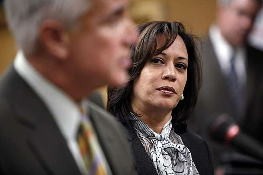 SF District Attorney Kamala Harris listens as SFPD Chief George Gascon addresses the press on Tuesday, March 9, 2010, about an SFPD lab technician that has been arrested on suspicion of stealing drugs seized as evidence in several criminal investigations.  The chief, flanked by SF District Attorney Kamala Harris and other law enforcement brass at, spoke about the thefts jeopardizing a number of cases in which the evidence no longer exists. Photo: Carlos Avila Gonzalez, The Chronicle