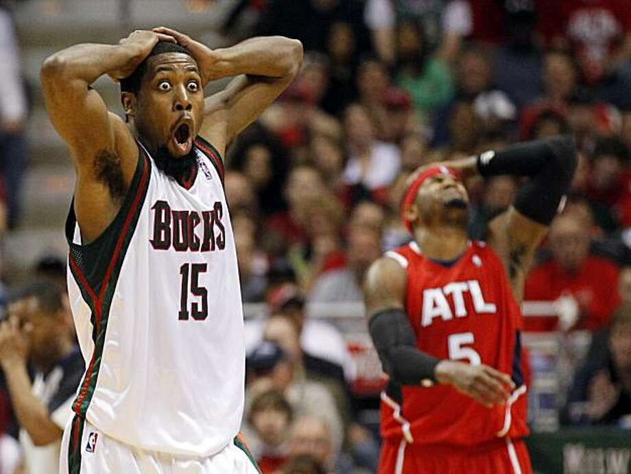 Milwaukee Bucks' John Salmons (15) and Atlanta Hawks' Josh Smith (5) react to a call during the first half of Game 3 of the first round of the NBA basketball playoffs Saturday, April 24, 2010, in Milwaukee. Photo: Jeffrey Phelps, AP