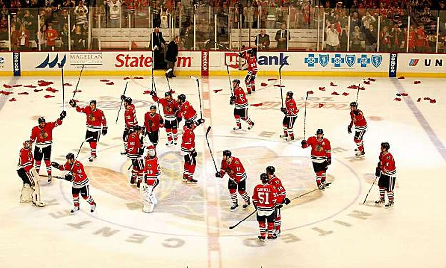 CHICAGO - APRIL 24: Members of the Chicago Blackhawks salute the crowd after a win over the Nashville Predators in Game Five of the Western Conference Quarterfinals during the 2010 NHL Stanley Cup Playoffs at the United Center on April 24, 2010 in Chicago, Illinois. The Blackhawks defeated the Predators 5-4 in overtime. Photo: Jonathan Daniel, Getty Images
