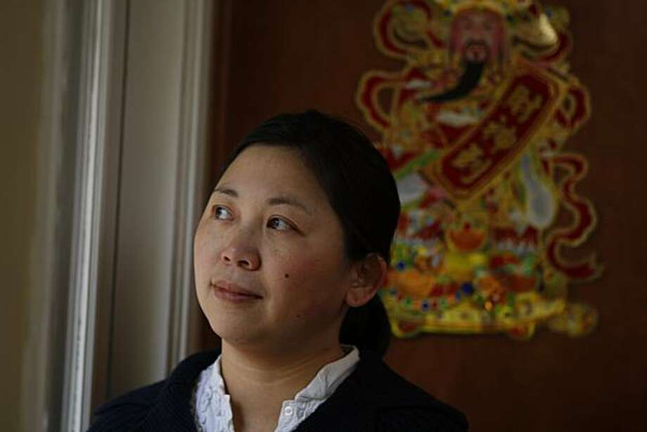 """Author Yiyun Li has a new book """"The Vagrants""""  at home in Oakland photographed on Friday, February 27, 2009. Photo: Eric Luse, The Chronicle"""