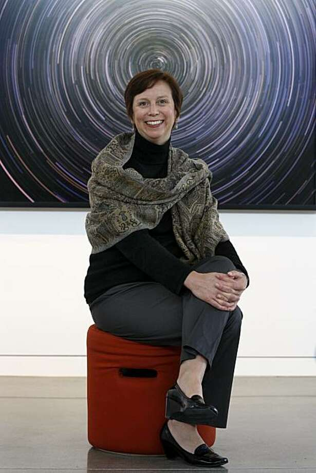 "Lori Fogarty, executive director of the Oakland Museum of California, is seen with ""Les Desmoiselles D'Avignon"" by artist Don Suggs in one of the museum's galleries in Oakland, Calif., on Friday, March 26, 2010. The museum is set to reopen in April after an extensive two-year renovation. Photo: Paul Chinn, The Chronicle"