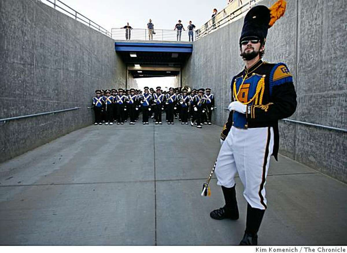Drum major Dave Jones waits for the signal to run onto the field before the U.C. Davis marching band performs at the U.C. Davis-Northern Colorado football game in Davis, Calif., on Saturday, Oct. 4, 2008.
