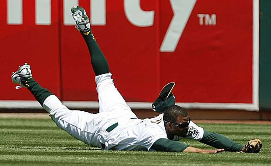 Oakland Athletics centerfielder Rajai Davis dives but cannot make the catch on a ball hit by Cleveland Indians' Mike Redmond during the sixth inning of a baseball game Saturday, April 24, 2010, in Oakland, Calif. Photo: Ben Margot, AP