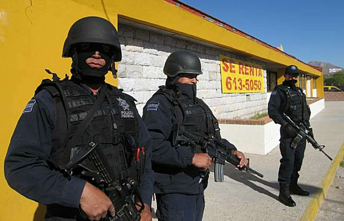 Thousands of heavily armed federal police patrol Ciudad Juarez, Mexico, to keep narcotics cartels at bay, April 8, 2010. (Tim Johnson/MCT)