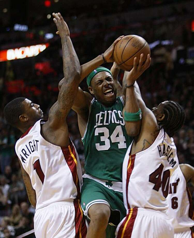 Boston Celtics forward Paul Pierce (34) goes up for a shot against Miami Heat forward Dorell Wright, left, and forward Udonis Haslem during the second half of Game 3 in the first round of their NBA basketball playoff series Friday, April 23, 2010, in Miami. The Celtics defeated the Heat 100-98. Photo: Wilfredo Lee, AP