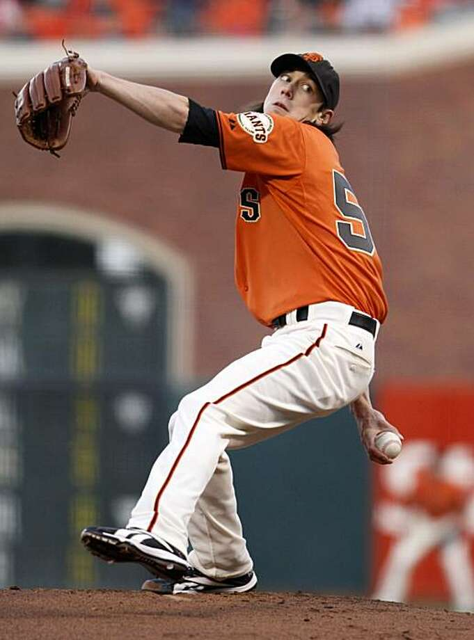 San Francisco Giants starting pitcher Tim Lincecum throws against the St. Louis Cardinals during the first inning of their baseball game in San Francisco, Friday, April 23, 2010.  San Francisco won the game 4-1 and Lincecum won his fourth start. Photo: Eric Risberg, AP