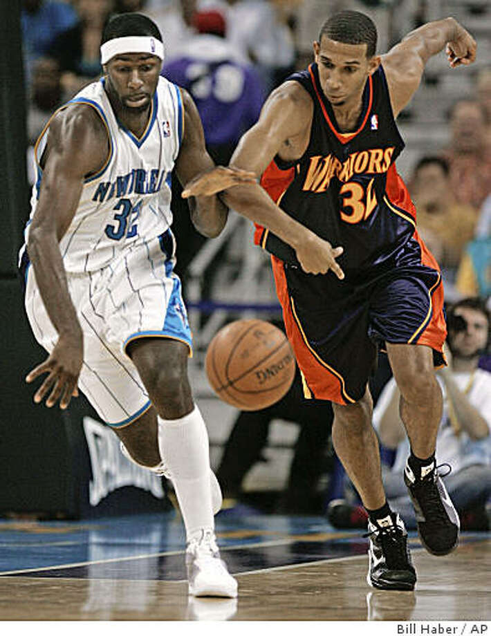 New Orleans Hornets Julian Wright, left, and Golden State Warriors Brandon Wright chase a loose ball in the first half of an NBA preseason basketball game in New Orleans, Sunday, Oct. 5, 2008. Photo: Bill Haber, AP