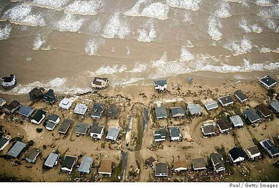GALVESTON, TX - SEPTEMBER 13:  In this aerial photo, damaged beach front homes are seen on Galveston Island after the passing of Hurricane Ike September 13, 2008 in Galveston, Texas. Ike caused extensive damage along the Texas Gold Coast, leaving millions without power. (Photo by Smiley N. Pool-Pool/Getty Images) Photo: Chronicle