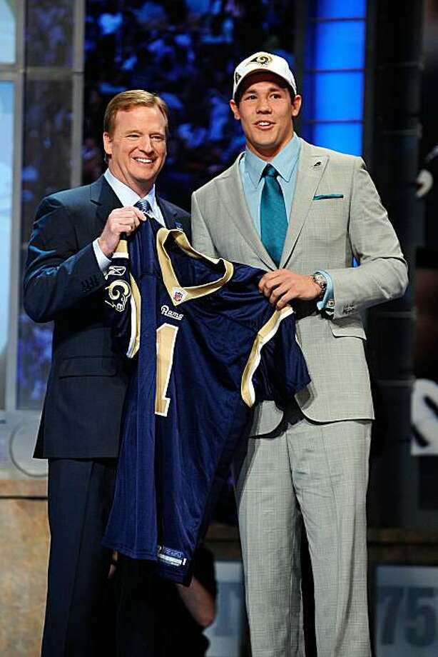 NEW YORK - APRIL 22:  Quarterback Sam Bradford of the Oklahoma Sooners holds up a St. Louis Rams jersey as he stands with NFL Commissioner Roger Goodell after Bradford was picked numer 1 overall by the Rams during the 2010 NFL Draft at Radio City Music Hall on April 25, 2009 in New York City. Photo: Jeff Zelevansky, Getty Images