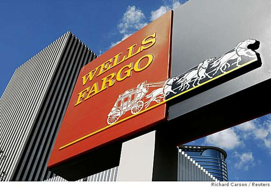 A Wells Fargo sign is seen outside a motor banking branch in downtown Houston October 3, 2008. Standard & Poor's on Friday said it may cut its ratings on Wells Fargo & Co, and may change Wachovia Corp's rating, after Wells Fargo said it would buy the bank for about $16 billion.     REUTERS/Richard Carson   (UNITED STATES) Photo: Richard Carson, Reuters