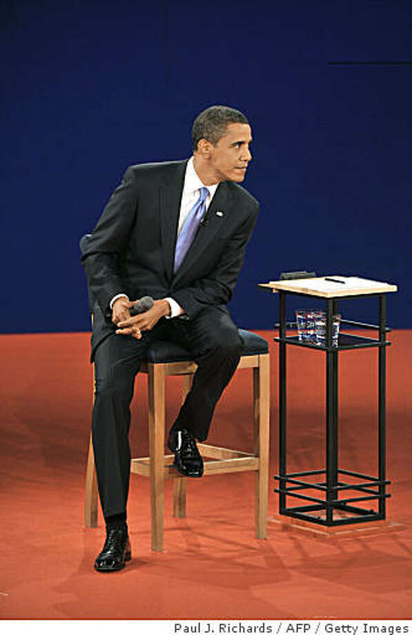 Democrat Barck Obama listens to Republican John McCain during their second presidential debate at Belmont University's Curb Event Center on October 7, 2008 in Nashville, Tennessee. Photo: Paul J. Richards, AFP / Getty Images