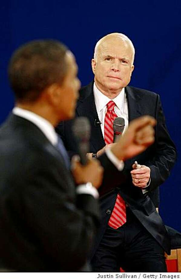Republican presidential candidate Sen. John McCain (R-AZ) and Democratic presidential candidate Sen. Barack Obama (D-IL)  take part in their Town Hall Presidential Debate at Belmont University's Curb Event Center October 7, 2008 in Nashville, Tennessee. Photo: Getty Images
