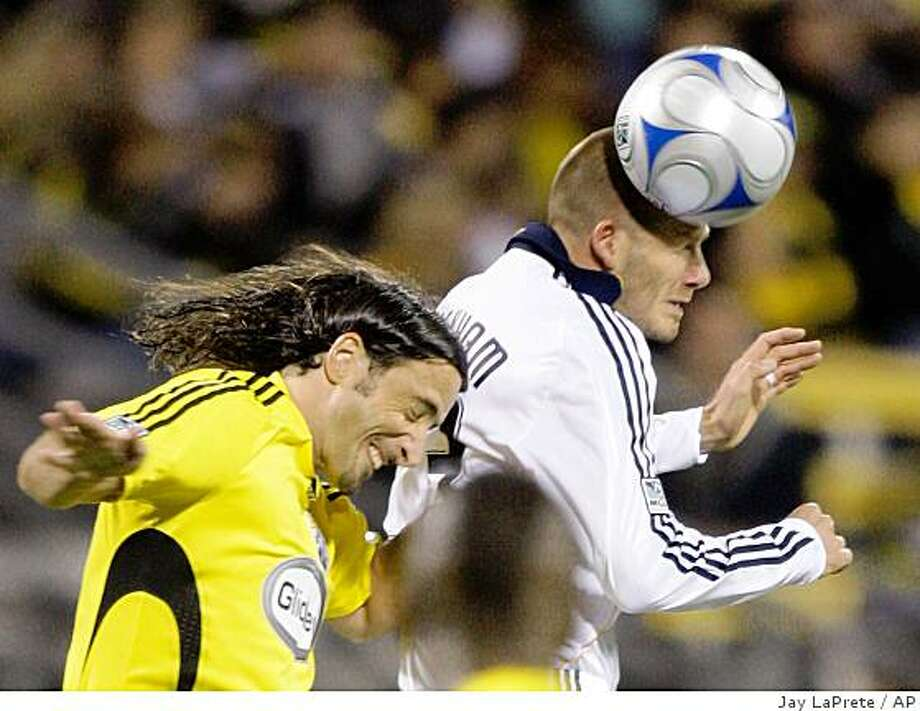 Los Angeles Galaxy's David Beckham, right, heads the ball past Columbus Crew's Gino Padula during the first half on Saturday, Oct. 4, 2008, in Columbus, Ohio. Photo: Jay LaPrete, AP