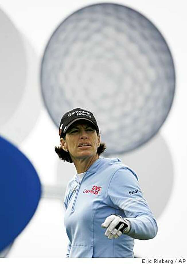 Juli Inkster follows her shot from the 17th tee during the third round of the Samsung World Championship in Half Moon Bay, Calif., Saturday, Oct. 4, 2008. Photo: Eric Risberg, AP