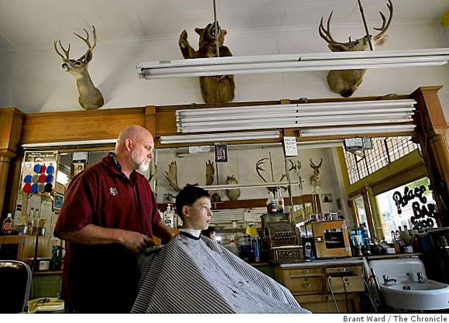 John Lisle, who runs the Palace Barber Shop in Yreka. He cuts the hair of 12 year old Garritt Bulkcom. Lisle is a proud supporter of the state of Jefferson. Some residents of northern California and southern Oregon are again talking about seceding from the United States and forming their own state called Jefferson. Photo: Brant Ward, The Chronicle