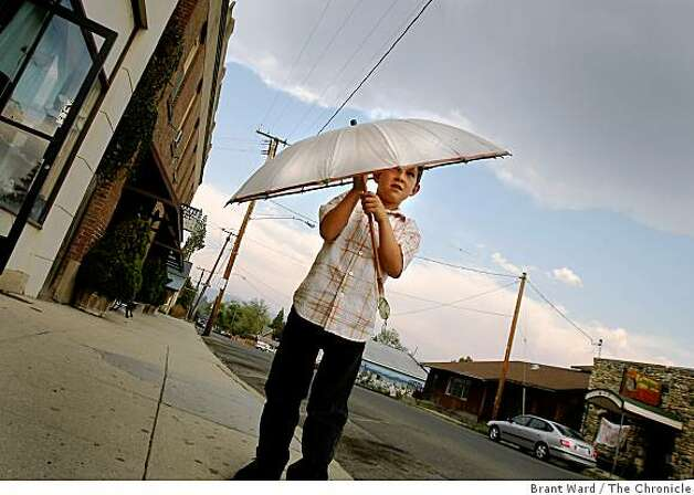 Matthew Martin uses an umbrella to shield him from a brief rainstorm in Etna, California. Matthew's father is a proponent of a new state of Jefferson. Some residents of northern California and southern Oregon are again talking about seceding from the United States and forming their own state called Jefferson. Photo: Brant Ward, The Chronicle