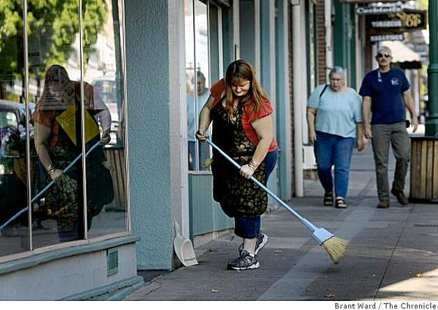 "Cheryl Fontanoza sweeps up outside her store on Miner Street in downtown Yreka. She laughs about the Jefferson state idea and calls it ""quaint."" Some residents of northern California and southern Oregon are again talking about seceding from the United States and forming their own state called Jefferson. Photo: Brant Ward, The Chronicle"