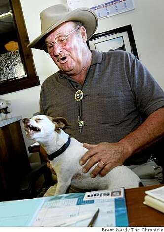 "Leo ""T"" Bergeron sits at his desk in Yreka, CA with his dog, Trouble. Bergeron and Grange halls throughout the area are seriously pushing the idea of a state of Jefferson. Some residents of northern California and southern Oregon are again talking about seceding from the United States and forming their own state called Jefferson. Photo: Brant Ward, The Chronicle"
