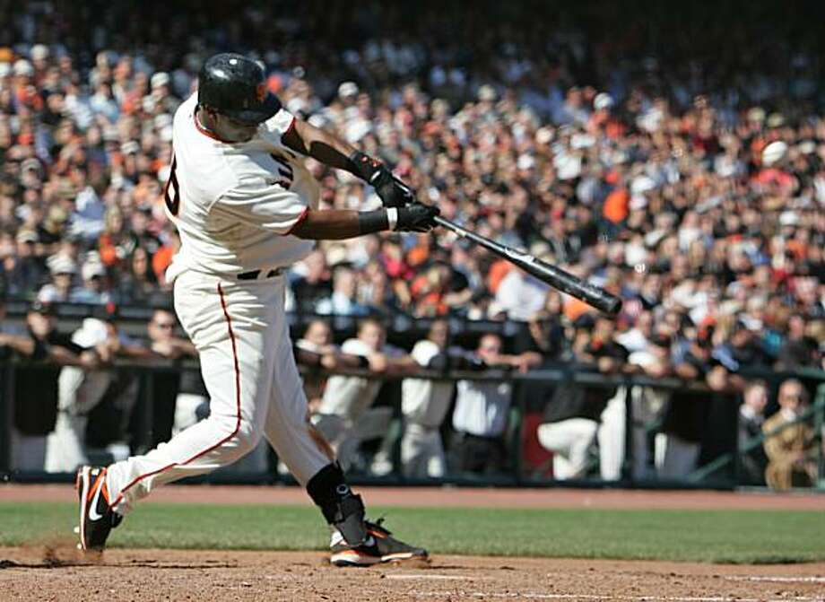 San Francisco Giants' Edgar Renteria hits a two-run home run off Atlanta Braves pitcher Billy Wagner in the ninth inning of their baseball game in San Francisco, Friday, April 9, 2010. Photo: Eric Risberg, AP