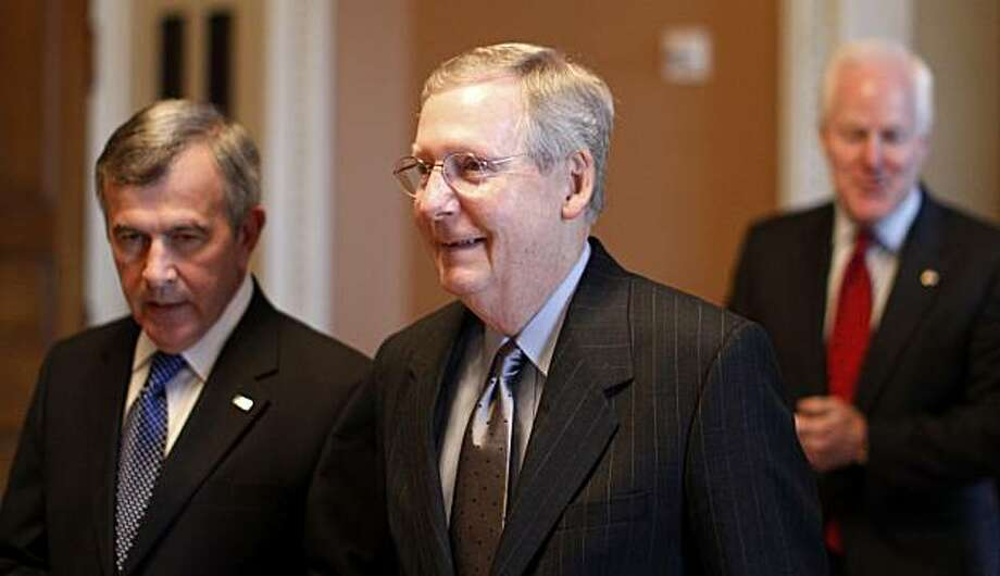 Senate minority leader Mitch McConnell, R-Ky., center, walks with Sen. Mike Johanns, R-Neb., left, and Sen. John Cornyn, R-Texas, towards the Senate floor for a crucial test vote for the financial reform bill on Capitol Hill in Washington, Monday, April 26, 2010. Photo: Charles Dharapak, AP