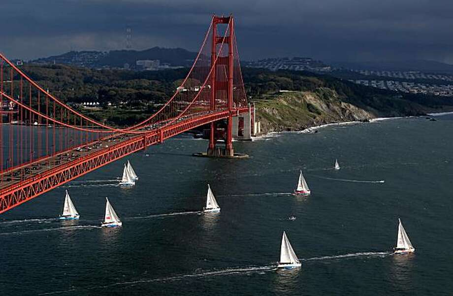 During a break in storm clouds on April 20, 68-foot race yachts representing nine different countres sail into the Pacific, destination Panama, at the start of the eighth leg in the Clipper Round the World Race 09-10. The start was at 6pm off Marina Green and Golden Gate Yacht Club. Approximately 180 sailors from some three dozen countries were aboard. Photo: Clipper Ventures
