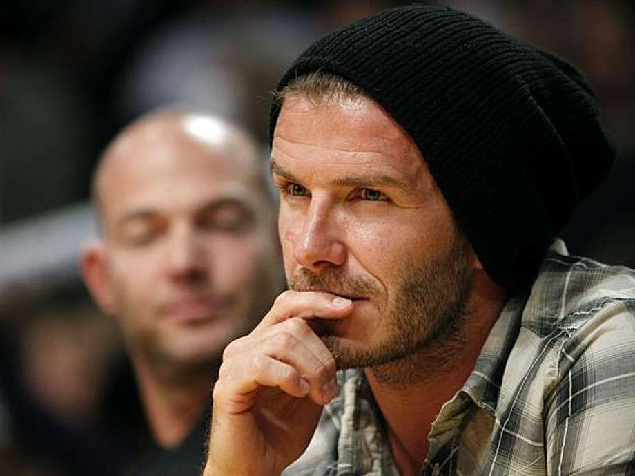 Soccer star David Beckham watches the Oklahoma City Thunder playing against the Los Angeles Lakers in the second half during game 2 of a first-round NBA basketball playoff series, Tuesday, April 20, 2010, in Los Angeles. Photo: Alex Gallardo, AP