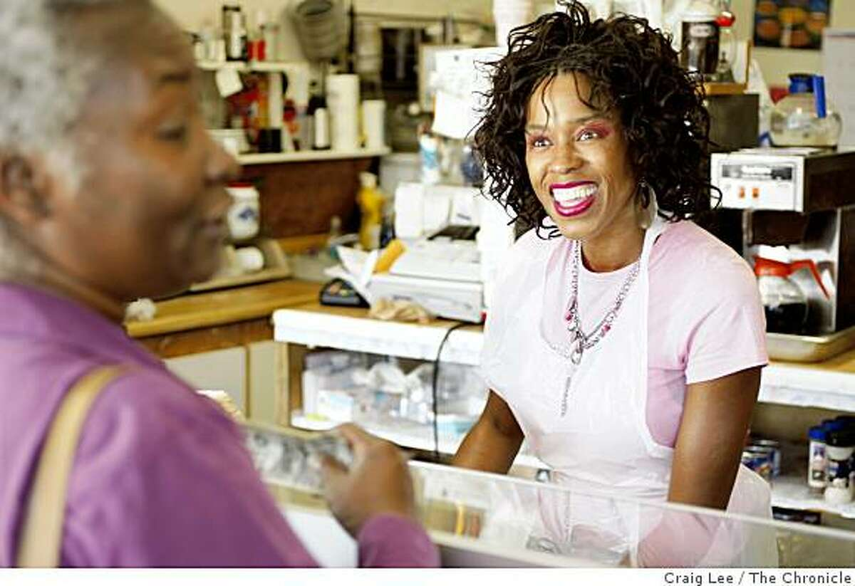 Barbara Howard (right) greets customer Betty Brown (left), at Wendy's Cheesecake Bakery in San Francisco, Calif., on October 7, 2008. The business is struggling to get by in these hard economic times and Barbara Howard, 44, helps her parents run Wendy's Cheesecake Bakery.