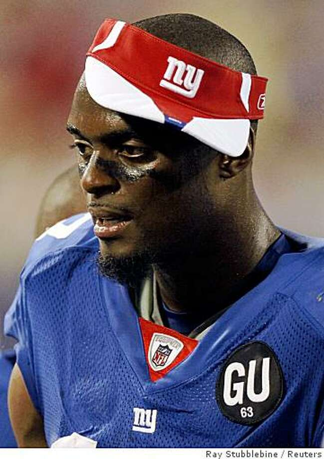 "Plaxico Burress wears a ""GU"" patch on his sweater in honor of Hall of Fame guard and long-time players union leader Gene Upshaw during their season opening NFL football game against the Washington Redskins in East Rutherford, in this file image from September 4, 2008. Photo: Ray Stubblebine, Reuters"