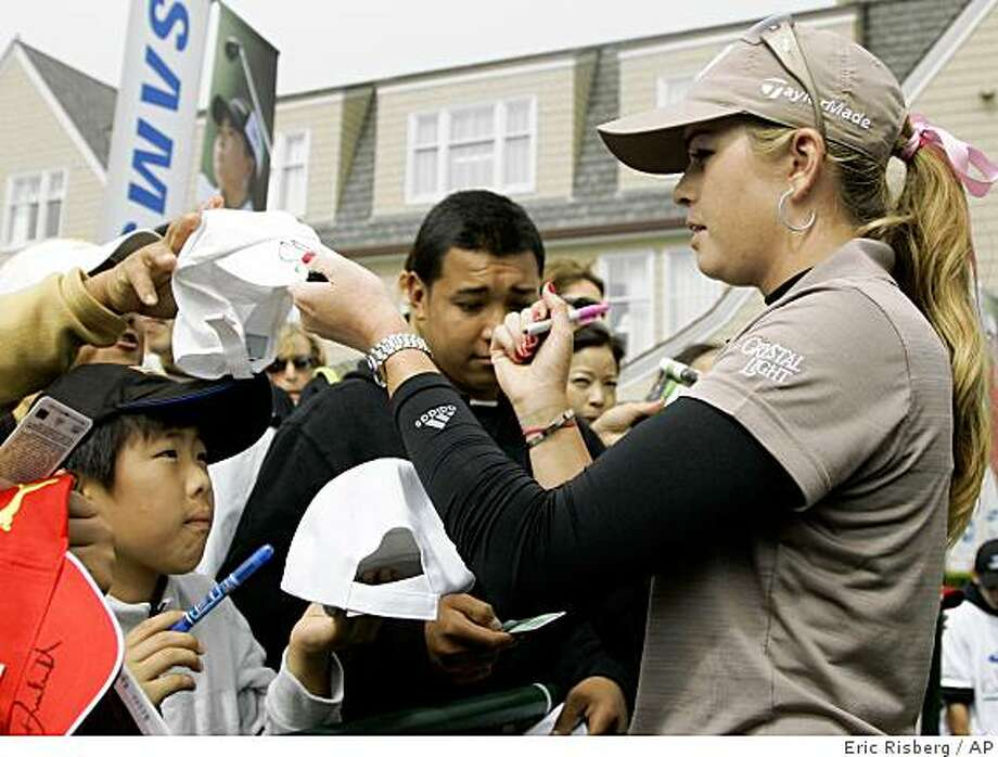 Paula Creamer signs autographs after finishing the third round of the Samsung World Championship golf tournament in Half Moon Bay, Calif., Saturday, Oct. 4, 2008. Creamer leads the tournament by one stroke after shooting a 4-under par 68 to finish at total 6-under par. (AP Photo/Eric Risberg) Photo: Eric Risberg, AP