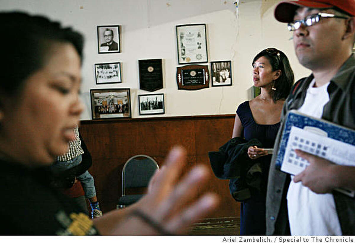 Melissa Canlas (center), an Asian American Studies teacher at San Francisco City College, and attendees explore the Daguhoy Lodge in Stockton during an educational walking tour of Stockton's Little Manila on Sunday afternoon. Dawn Mabalon (left), co-founder of the Little Manila Foundation, lead the tour and explained the history of the California Filipino community before attendees viewed 'The Romance of Magno Rubio' at Stockton's Bob Hope Theater.