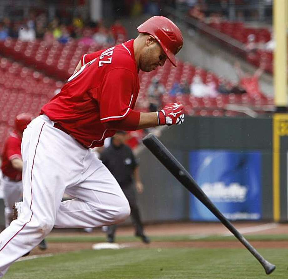Cincinnati Reds' Ramon Hernandez runs to first base after hitting in the go-ahead run in the eighth inning of a baseball game against the San Diego Padres, Sunday, April 25, 2010, in Cincinnati. The Reds won 5-4. Photo: David Kohl, AP