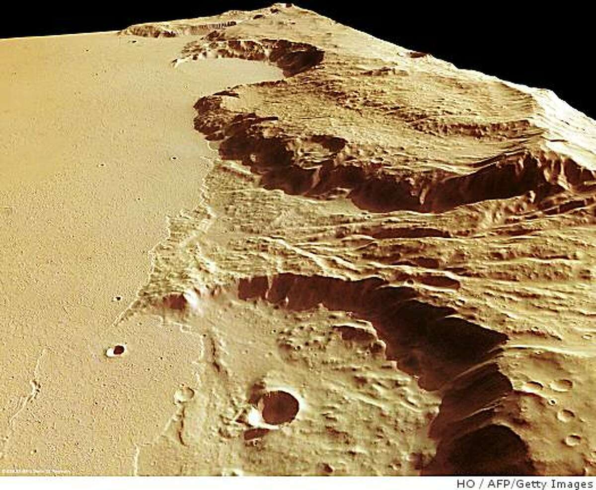 A high-resolution stereo camera-obtained (HRSC) image released on September 26, 2008 by the European Space Agency (ESA) shows the Mangala Fossae trough, a system of outflow channels on Mars, that bears evidence of lava deposition and catastrophic floods. The HRSC on board Mars Express obtained images on March 21, 2007. The Mangala Fossae is approximately 1,000 kms long, located south-west of the volcanic region Tharsis, where the highest known volcano in the solar system, Olympus Mons, is located. AFP PHOTO / ESA/ DLR/ FU Berlin RESTRICTED TO EDITORIAL USE (Photo credit should read HO/AFP/Getty Images)