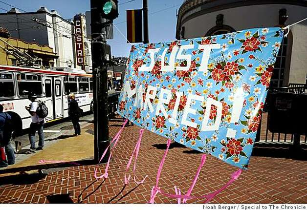 A banner celebrating same-sex marriage flies on Castro St. on Tuesday, June 17, 2008, in San Francisco.Photo by Noah Berger / Special to the Chronicle Photo: Noah Berger, Special To The Chronicle