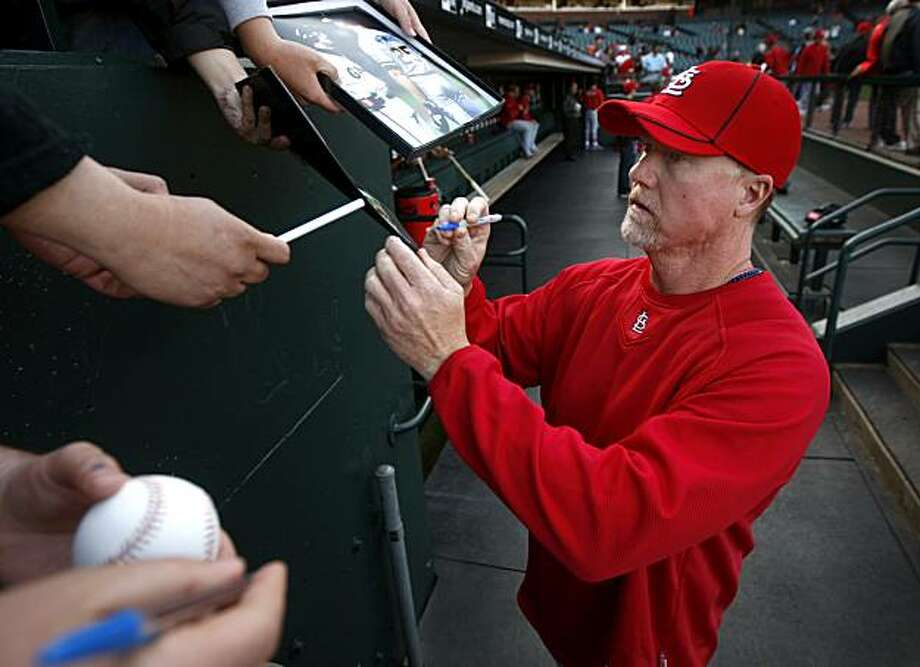 St. Louis Cardinals batting coach Mark McGwire signs autographs for fans before a game against the San Francisco Giants at AT&T Park in San Francisco, Calif., on Friday, April 23, 2010. The former Oakland A's slugger made his first return to the Bay Area in a baseball uniform since the steroids scandal rocked the baseball world. Photo: Paul Chinn, The Chronicle