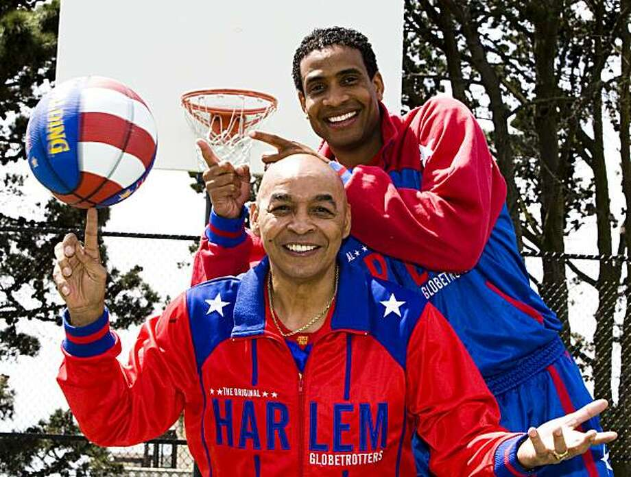 """Harlem Globetrotters Curly Neal (front) and Wun """"The Shot"""" Versher (back) pose for a portrait on Monday, April 19th, 2010. Photo: Ali Thanawalla, The Chronicle"""