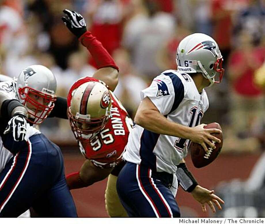 New England Patriots quarterback Matt Cassel (16) throws under pressure from San Francisco 49ers Tully Banta-Cain (95) during a NFL game at Candlestick Park in San Francisco, Calif., on October 5, 2008. Photo: Michael Maloney, The Chronicle