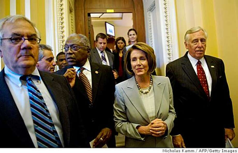 US Speaker of te House Nancy Pelosi (2nd R) smiles as she walks with with Democratic Representative from Illinois Rahm Emanuel (2nd L), House Financial Services Committee chairman Barney Frank (L), Majority Whip James Clyburn (3rd L) and Majority Leader Steny Hoyer (R) at the Capitol in Washington on October 3, 2008 after the House of Representatives approved the plan, bowing to intense pressure to help avert a global economic meltdown. The House, which sparked market and political turmoil by rejecting an earlier version of the bailout on September 29 by 228 votes to 205, voted 263 for to 171 against in favor of the largest US government economic intervention since the Great Depression of the 1930s.         AFP PHOTO/Nicholas KAMM (Photo credit should read NICHOLAS KAMM/AFP/Getty Images) Photo: Nicholas Kamm, AFP/Getty Images