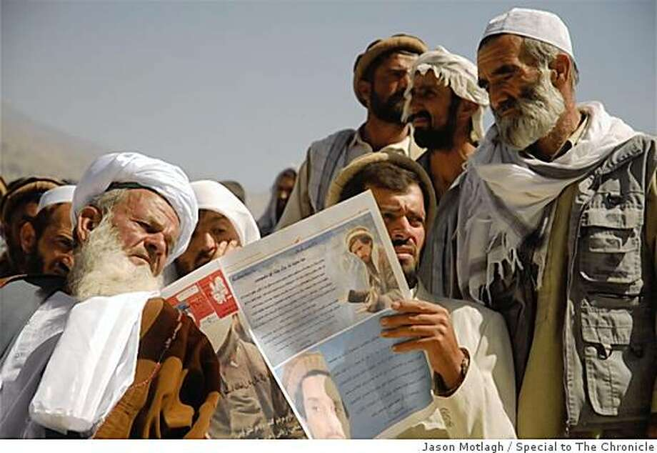 Afghan elders read an independent newspaper at an event in Panjshir province honoring the anniversary of the death of  Ahmad Shah Massoud, the anti-Taliban military leader who was assassinated by alleged al Qaeda agents. Photo: Jason Motlagh, Special To The Chronicle